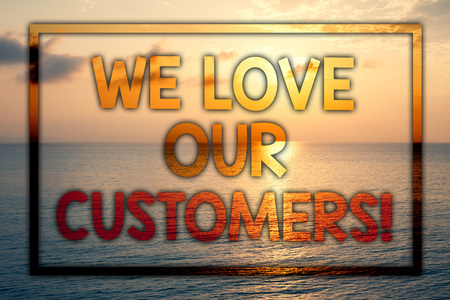 Writing note showing  We Love Our Customers Call. Business photo showcasing Client deserves good service satisfaction respect Sunset blue beach cloudy sky ideas message thoughts feelings Stockfoto