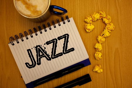 Handwriting text Jazz. Concept meaning Type of music of black American origin Musical genre Strong rhythm Ideas grunge notebook coffee cup crumpled papers equal sign wooden wood