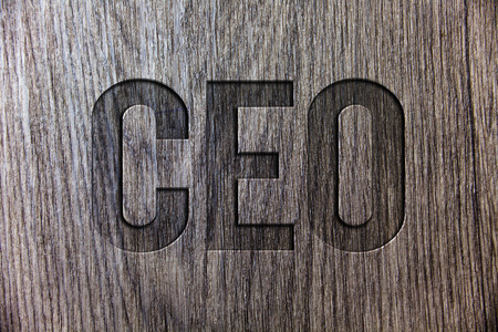 Conceptual hand writing showing Ceo. Business photo showcasing Chief Executive Officer Head Boss Chairperson Chairman Controller Wooden background vintage wood board message ideas feelings