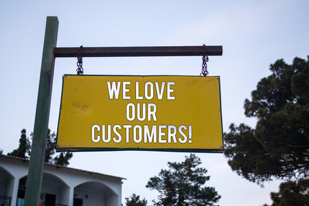 Word writing text We Love Our Customers Call. Business concept for Client deserves good service satisfaction respect Wooden board hang hanging post ideas messages feelings trees blue sky