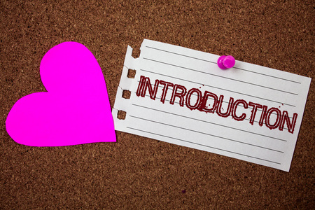 Handwriting text Introduction. Concept meaning First part of a document Formal presentation to an audience Piece notebook paper grunge ideas pink heart cork background love lovely
