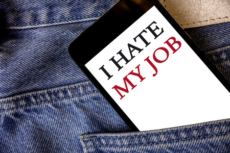 Conceptual hand writing showing I Hate My Job. Business photo text Hating your position Disliking your company Bad career Cell phone white screen message application wicker background