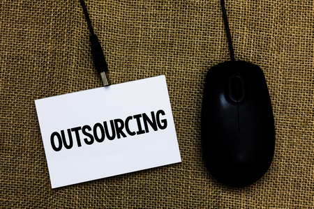 Writing note showing Outsourcing. Business photo showcasing Obtain goods or service by contract from an outside supplier Sticky card type text convey message computer mouse jute background