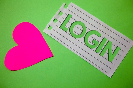 Conceptual hand writing showing Login. Business photo showcasing Act of entering into a computer database or system Starting session Small paper drawing heart green background remember message Stock Photo