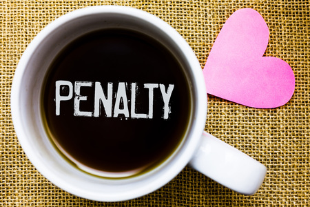 Text sign showing Penalty. Conceptual photo Punishment imposed for breaking a law rule or contract Sports term Tea time coffee cup office typing work jute rough background love heart