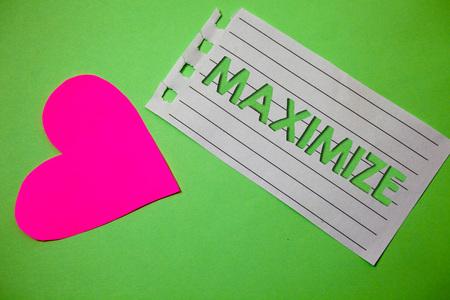 Conceptual hand writing showing Maximize. Business photo showcasing Increase to the greatest possible amount or degree Make larger Small paper drawing heart green background remember message Stock Photo