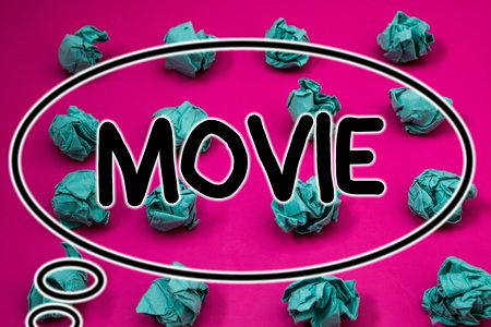 Word writing text Movie. Business concept for Cinema or television film Motion picture Video displayed on screen Crumpled paper balls pattern eliptical design animated font background