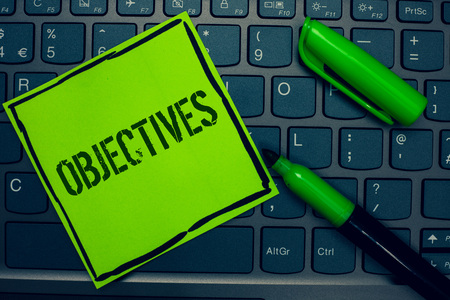 Conceptual hand writing showing Objectives. Business photo text Goals planned to be achieved Desired targets Company missions Keyboard sticky card marker pen office job computer study class
