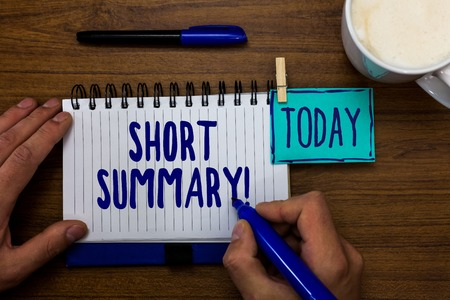 Handwriting text Short Summary Motivational Call. Concept meaning Brief statement of main points clear Marker pens notepad cup milk coffee daily memories dairy clip paperclip