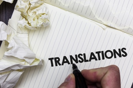 Conceptual hand writing showing Translations. Business photo showcasing Written or printed process of translating words text voice Paper object notepad crumpled papers ideas several tries