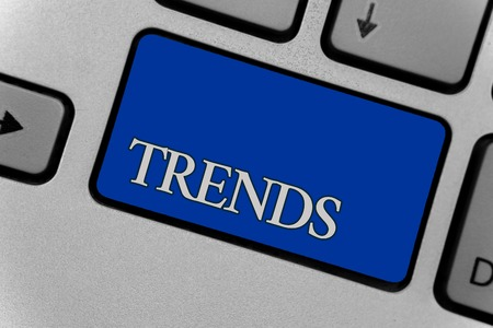 Conceptual hand writing showing Trends. Business photo text General projected directions of something according to time Keyboard grey key silver laptop create computer keypad notebook