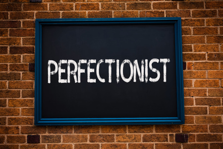 Conceptual hand writing showing Perfectionist. Business photo showcasing Person who wants everything to be perfect Highest standards Framed hang black board study class brick wall background