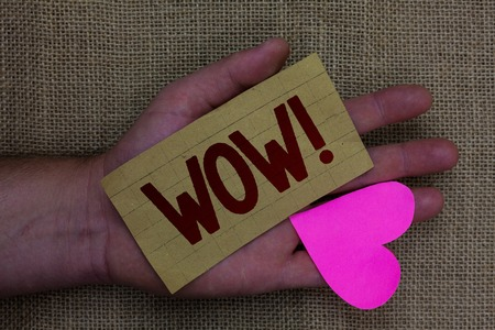 Writing note showing Wow Motivational Call. Business photo showcasing Expression of somebody speechless amazed overjoyed Wood art work memories lovely love thoughts mat memories hart shadow