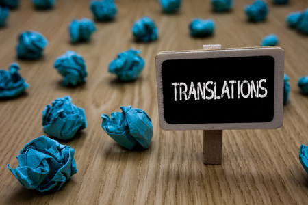 Writing note showing Translations. Business photo showcasing Written or printed process of translating words text voice Cyan paper imagination idea crumpled papers mistakes several tries Imagens