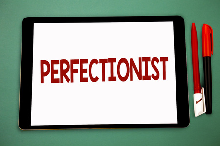 Conceptual hand writing showing Perfectionist. Business photo showcasing Person who wants everything to be perfect Highest standards Wide framed white tablet board smart screen pen cap learn Stock Photo