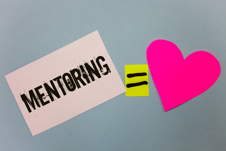 Handwriting text writing Mentoring. Concept meaning To give advice or support to a younger less experienced person Equal symbol sticky notes heart love plane coloured background calculation Stockfoto