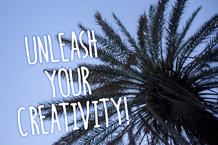 Handwriting text Unleash Your Creativity Call. Concept meaning Develop Personal Intelligence Wittiness Wisdom Tall palm tree blue sky ideas messages thoughts feelings reflections