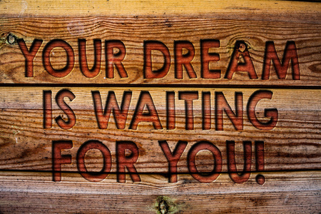 Handwriting text Your Dream Is Waiting For You. Concept meaning Goal Objective Intention Target Yearning Plan Wooden background vintage wood board wild message ideas intentions thoughts Stock Photo