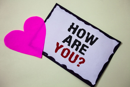 Text sign showing How Are You Question. Conceptual photo Your Health status Asking about your life and health Hart love pink white background love lovely thoughts message memories Stock Photo