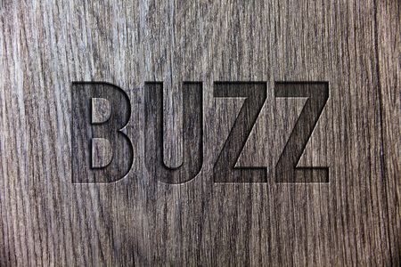 Conceptual hand writing showing Buzz. Business photo showcasing Hum Murmur Drone Fizz Ring Sibilation Whir Alarm Beep Chime Wooden background vintage wood board message ideas feelings