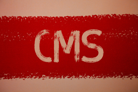 Text sign showing Cms. Conceptual photo Content Management System supports modification of digital content Ideas messages red paint painting light brown background messy intentions