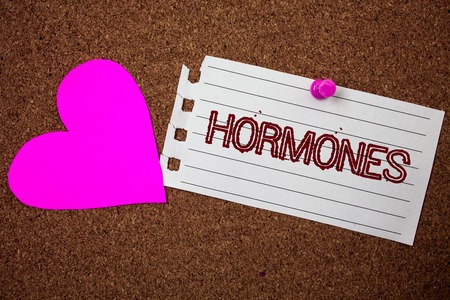 Handwriting text Hormones. Concept meaning Regulatory substance produced in an organism to stimulate cells Piece notebook paper grunge ideas pink heart cork background love lovely