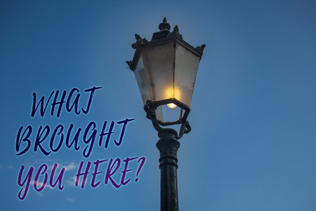 Handwriting text writing What Brought You Here Question. Concept meaning Ambition can be obtain by determination Light post blue sky enlighten ideas message reflection thoughts intentions Stock Photo