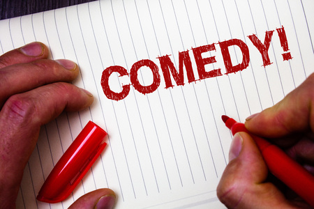 Conceptual hand writing showing Comedy Call. Business photo showcasing Fun Humor Satire Sitcom Hilarity Joking Entertainment Laughing Man hold holding marker paper thoughts messages intentions
