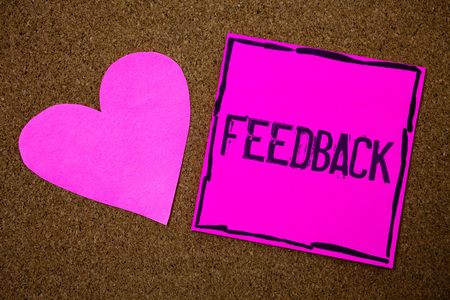 Handwriting text writing Feedback. Concept meaning Customer Review Opinion Reaction Evaluation Give a response back Cork background pink paper papers ideas messages heart love lovely inspire Stock Photo