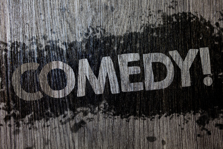 Text sign showing Comedy Call. Conceptual photo Fun Humor Satire Sitcom Hilarity Joking Entertainment Laughing Wooden wood background black splatter paint ideas messages intentions