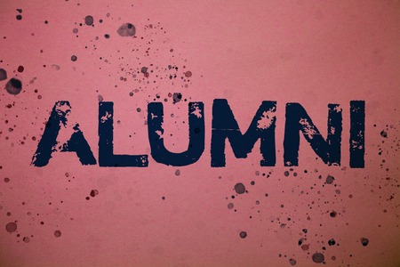 Handwriting text Alumni. Concept meaning Alum Old graduate Postgraduate Gathering College Academy Celebration Ideas messages pink background splatters messy paint communicate feelings Stock Photo