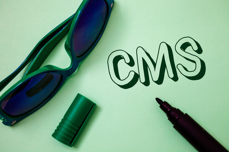 Writing note showing  Cms. Business photo showcasing Content Management System supports modification of digital content Ideas messages white background open marker sunglasses communicate 写真素材