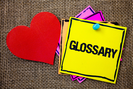 Writing note showing  Glossary. Business photo showcasing Alphabetical list of terms with meanings Vocabulary Descriptions Ideas messages paper papers red heart love message jute background Stockfoto