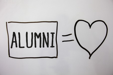 Conceptual hand writing showing Alumni. Business photo showcasing Alum Old graduate Postgraduate Gathering College Academy Celebration Ideas messages heart white background intentions feelings