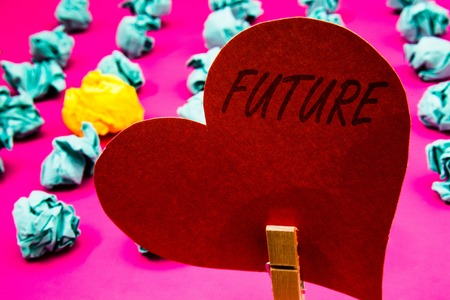 Handwriting text Future. Concept meaning Period of time following the present moment Events that will happen Clothespin holding red heart paper crumpled papers ideas mistakes trials