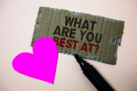 Text sign showing What Are You Best At Question. Conceptual photo Individual creativity is a unique capability Brown paperboard rough ideas message heart wild love lovely intentions