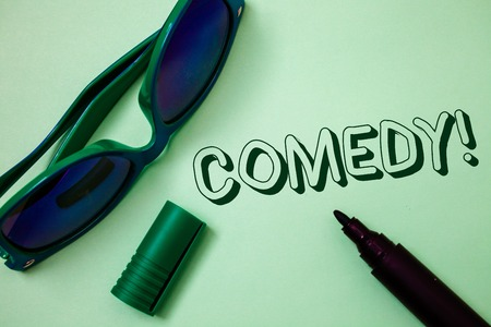 Writing note showing  Comedy Call. Business photo showcasing Fun Humor Satire Sitcom Hilarity Joking Entertainment Laughing Ideas messages white background open marker sunglasses communicate