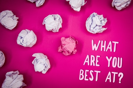 Conceptual hand writing showing What Are You Best At Question. Business photo text Individual creativity is a unique capability Ideas pink background crumpled papers trial mistakes several tries Фото со стока