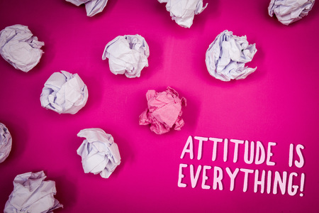Conceptual hand writing showing Attitude Is Everything. Business photo text Personal Outlook Perspective Orientation Behavior Ideas pink background crumpled papers trial mistakes several tries