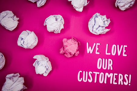 Conceptual hand writing showing We Love Our Customers Call. Business photo text Client deserves good service satisfaction respect Ideas pink background crumpled papers trial mistakes several tries 写真素材