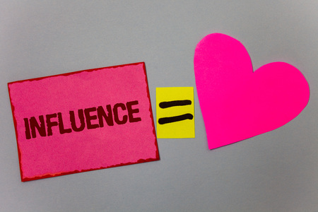 Text sign showing Influence. Conceptual photo Capacity to have effect on others character development behavior Paper Heart equal sign gray background intentions love lovely messages