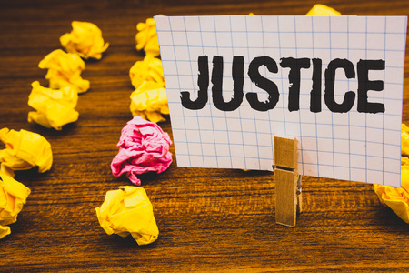 Conceptual hand writing showing Justice. Business photo text Quality of being just impartial or fair Administration of law rules Clothespin hold holding notebook paper crumpled papers ideas