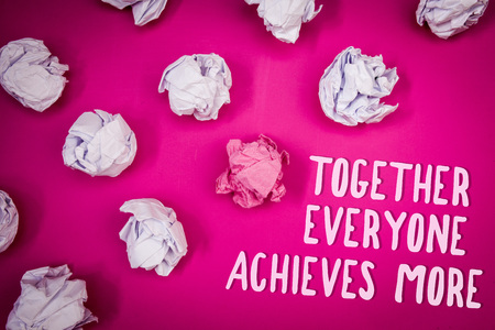 Conceptual hand writing showing Together Everyone Achieves More. Business photo text Teamwork Cooperation Attain Acquire Success Ideas pink background crumpled papers trial mistakes several tries Foto de archivo