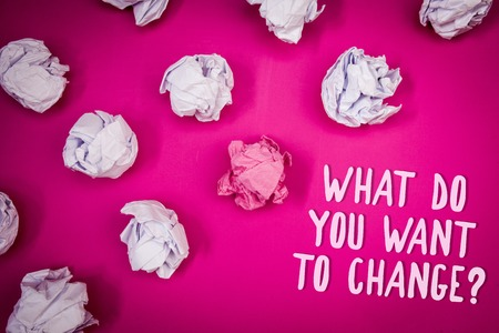 Conceptual hand writing showing What Do You Want To Change Question. Business photo text Strategy Planning Decision Objective Ideas pink background crumpled papers trial mistakes several tries