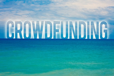Word writing text Crowdfunding. Business concept for Funding a project by raising money from large number of people Blue beach water cloudy clouds sky natural scene landscape message idea
