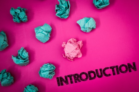 Word writing text Introduction. Business concept for First part of a document Formal presentation to an audience Ideas messages thoughts pink background crumpled papers several tries Stockfoto
