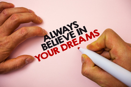 Writing note showing  Always Believe In Your Dreams. Business photo showcasing confidence Faith Believing in yourself Marker pen paper Ideas messages remember information important pink