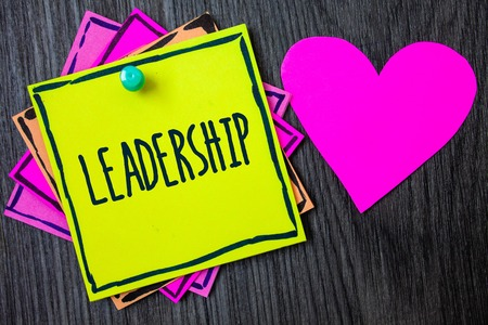 Handwriting text writing Leadership. Concept meaning Ability Activity involving leading a group of people or company Border sticky remember cards love heart pinned dark woody background