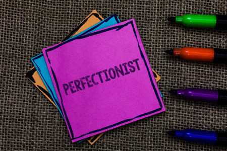 Text sign showing Perfectionist. Conceptual photo Person who wants everything to be perfect Highest standards Multiple colour sticky remember cards pen script marker jute background Stock Photo