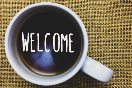 Handwriting text writing Welcome. Concept meaning Warm salutation acknowledgement for someone amiable loved thanked Mug coffee thoughts ideas creative inspirations nice mat black shadow